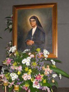 sr. Romero con fiori