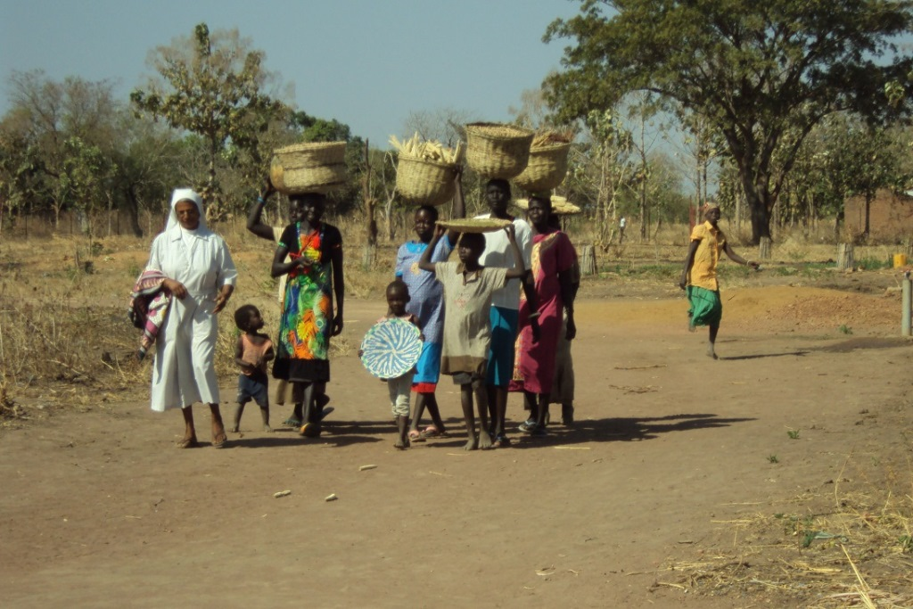 Women carrying the harves